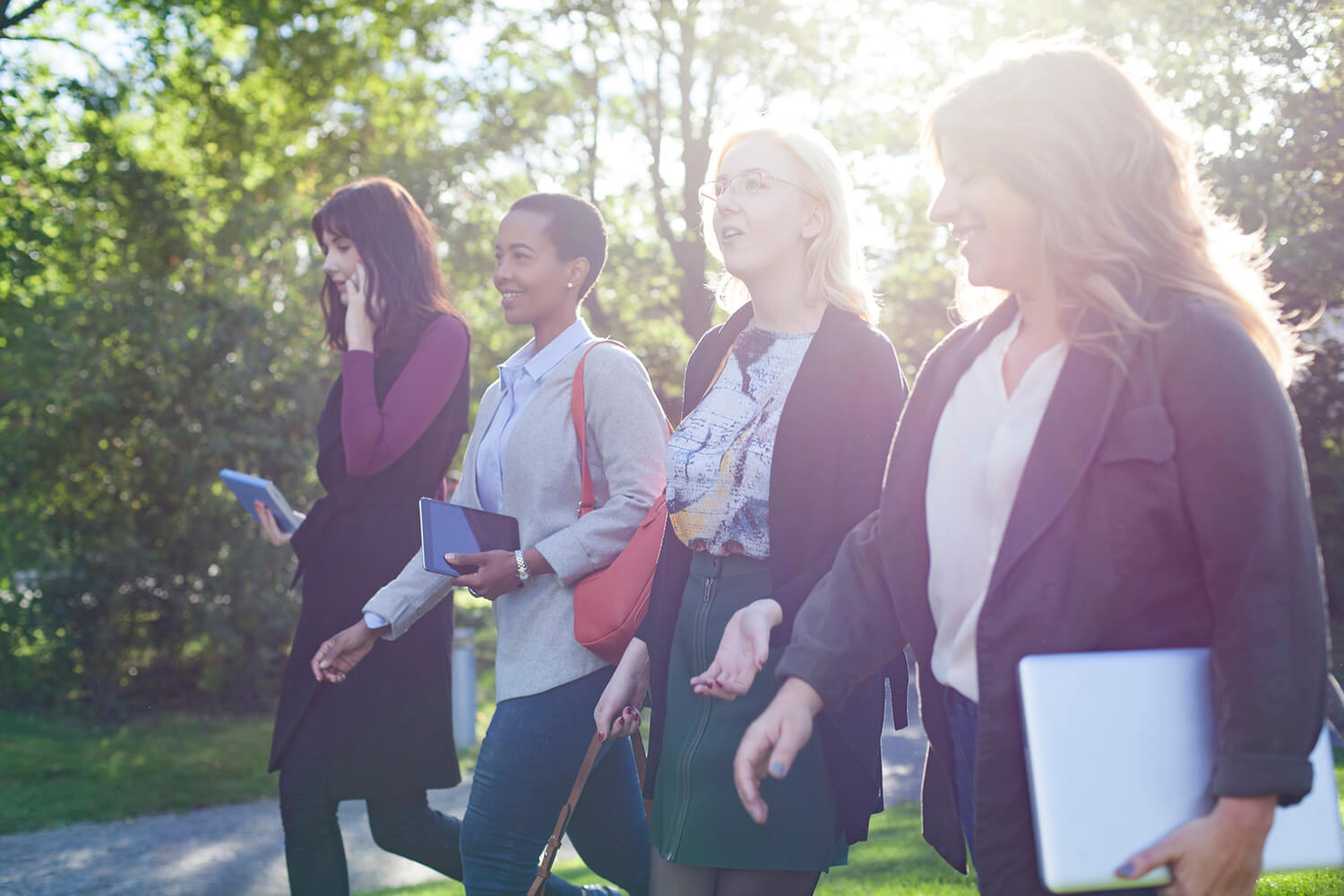 Group of female tech students walking outdoors