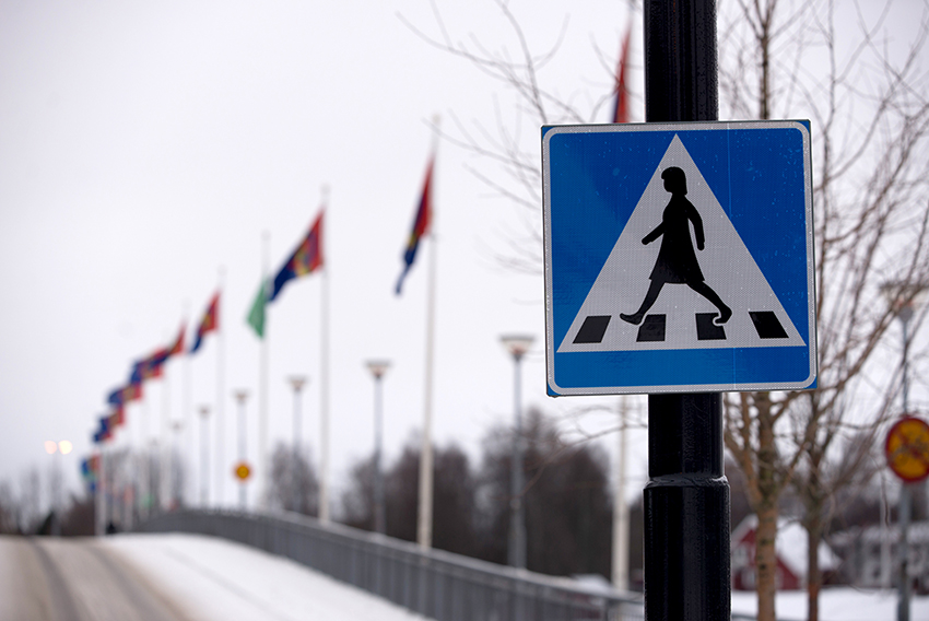 Pedestrian crossing road sign depicting a woman to promote gender equality