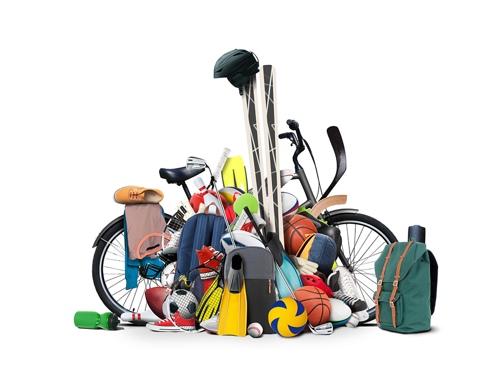 A bunch of sports equipment piled up on a bicycle