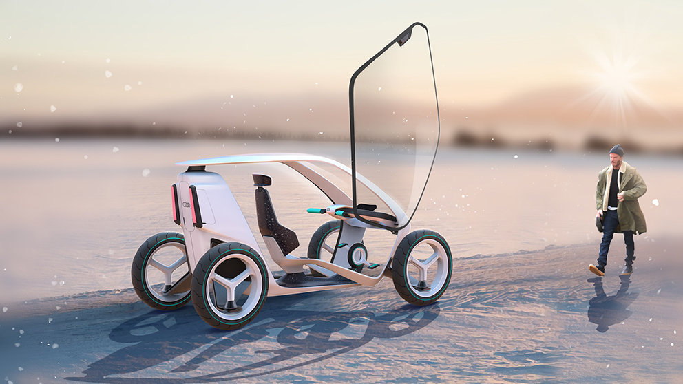 A conceptual vehicle and a person walking by it on a winter day