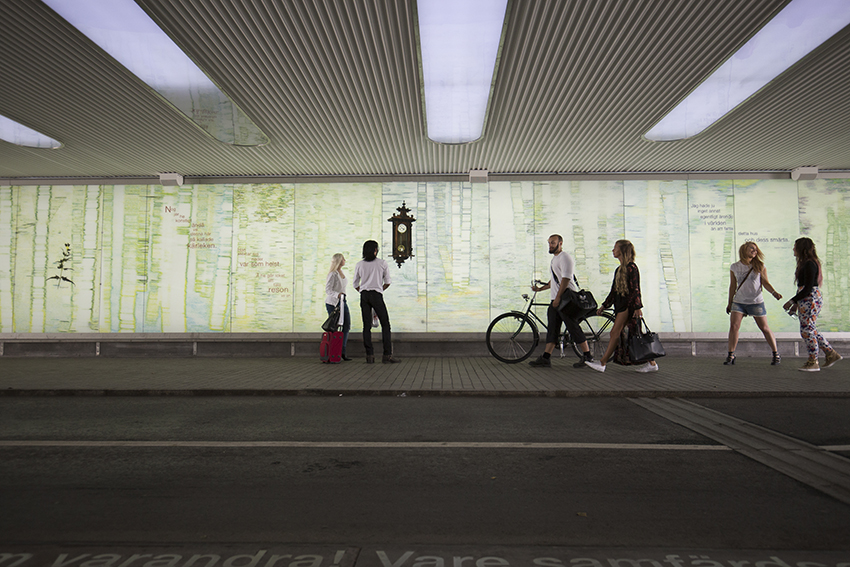 Six persons walking in the station tunnel in Umeå