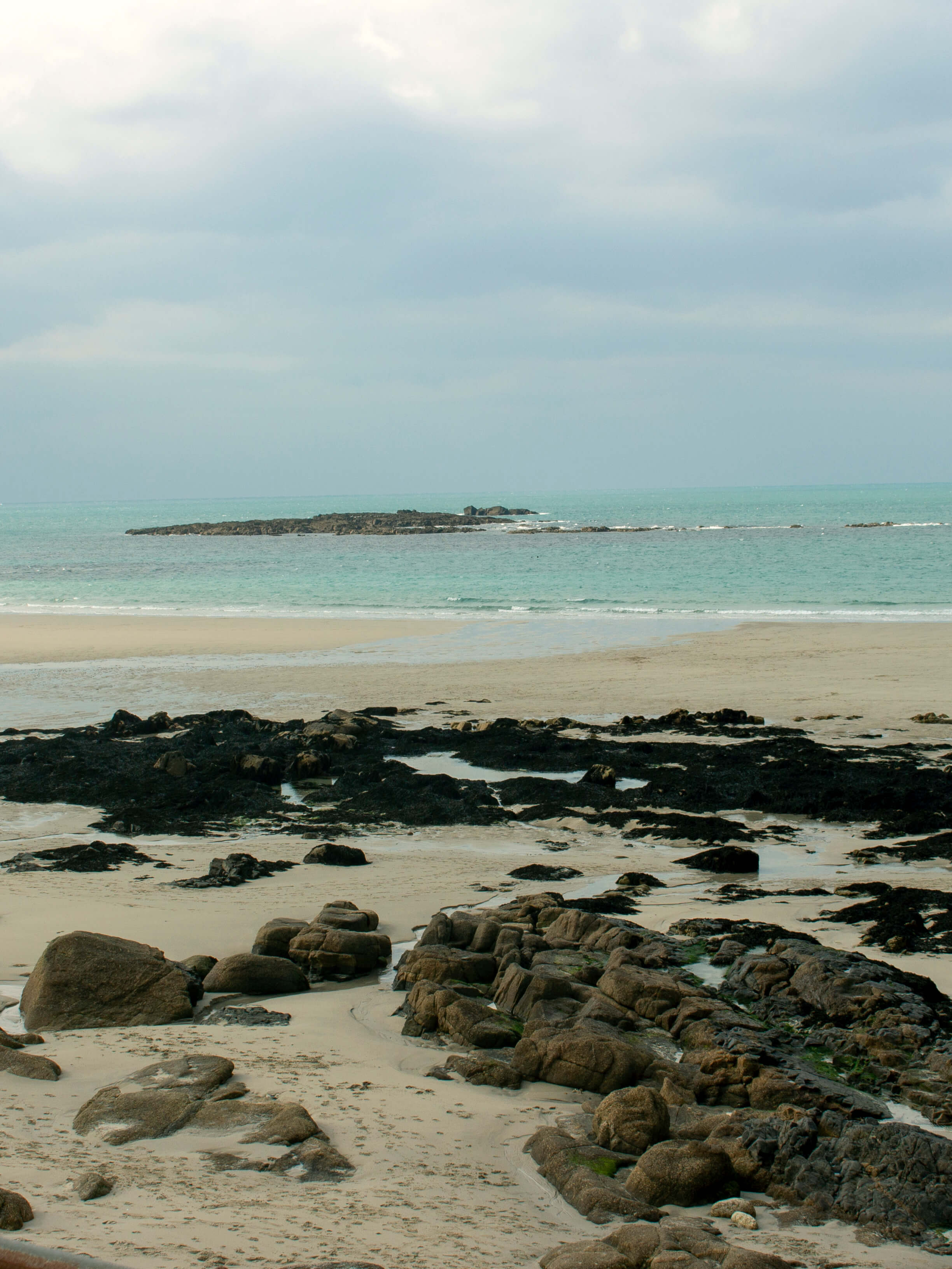 a beach at one of the most south-westerly points in the UK. Rocks in front on the beach with the ocean in the background
