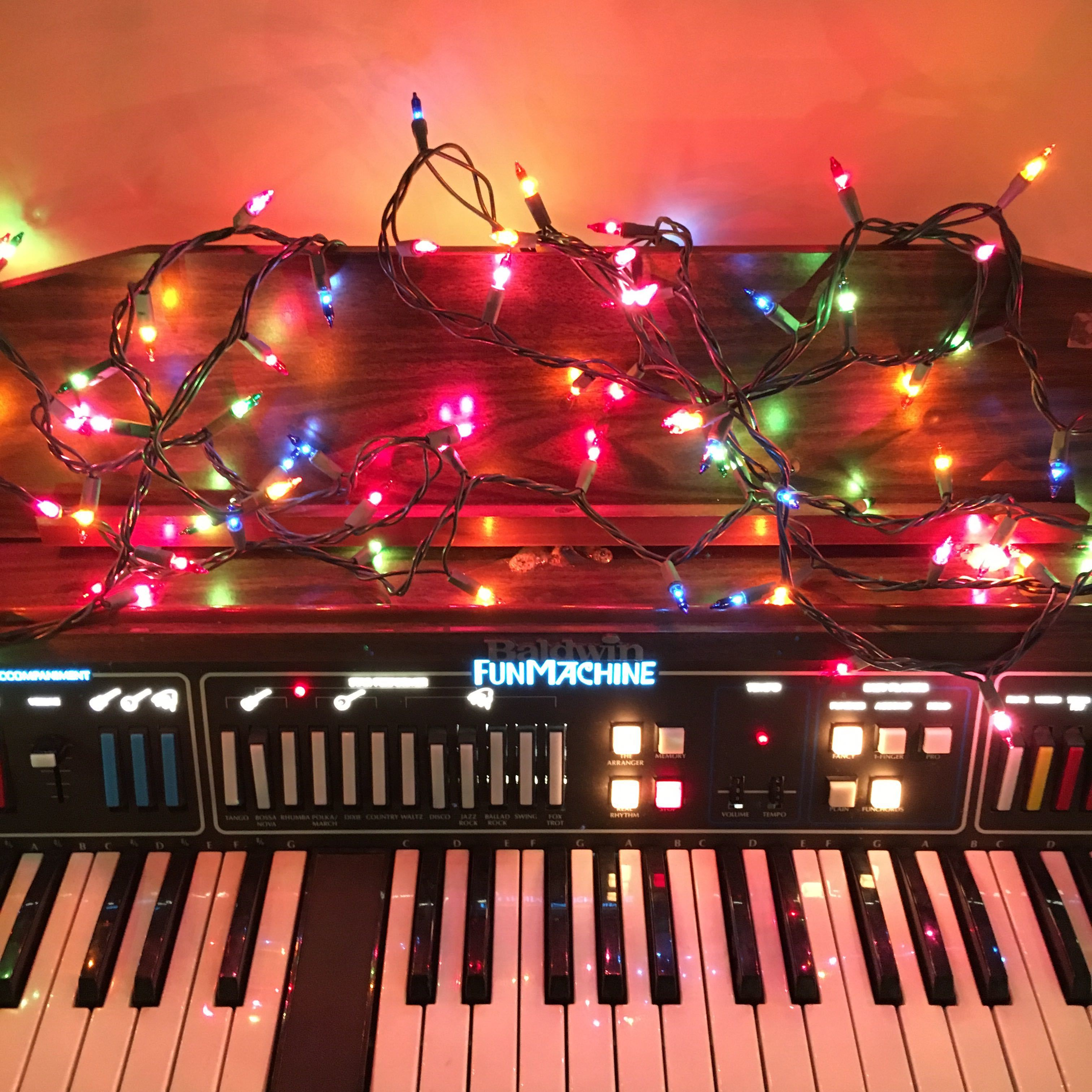 A vintage Baldwin Fun Machine covered in lights