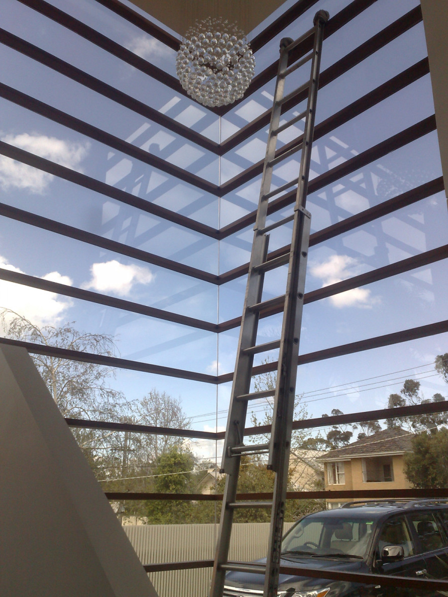 Cleaning windows in a Melbourne home