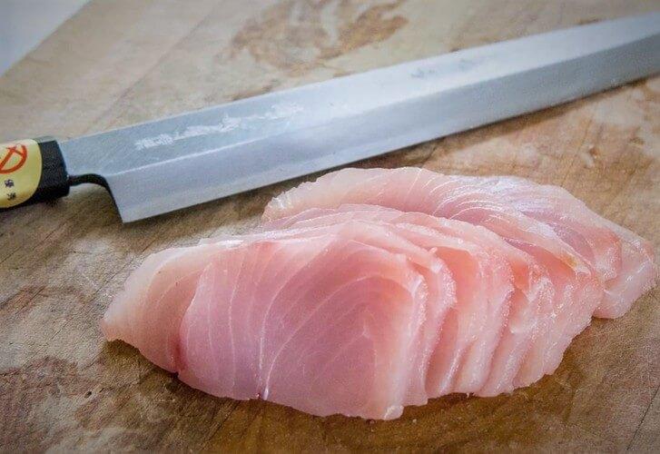 Garlic, soy and ginger infused kingfish sashimi