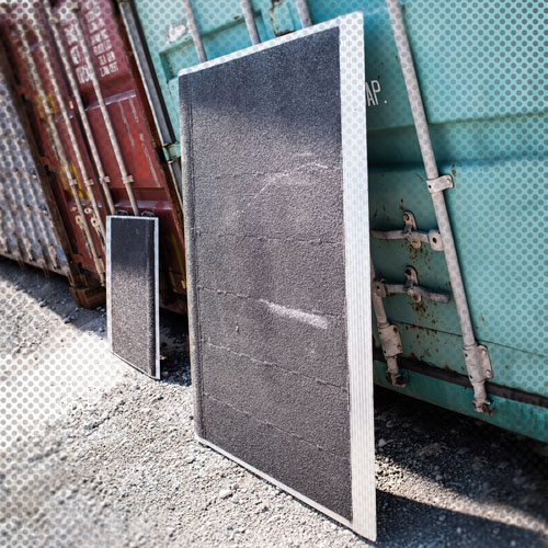 ground access ramps leaning against a shipping container