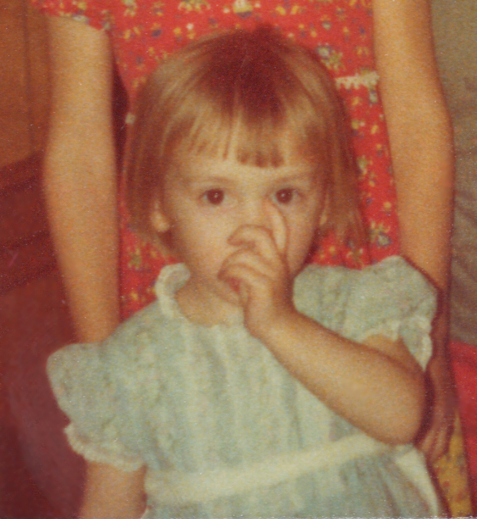 The author at the age of 2, sucking her thumb.