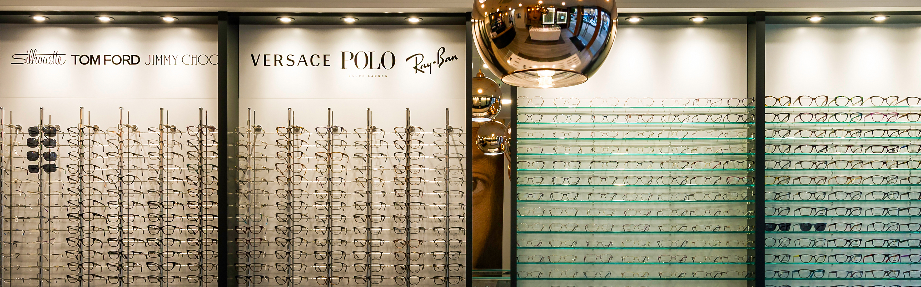 eyedeal vision opticians glsses display wall