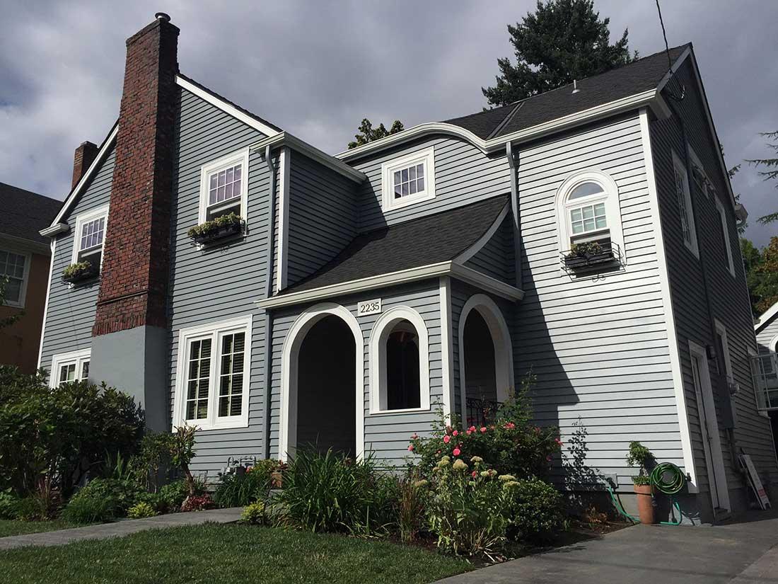 GRAY HOUSE WHITE TRIM BRICK CHIMNEY