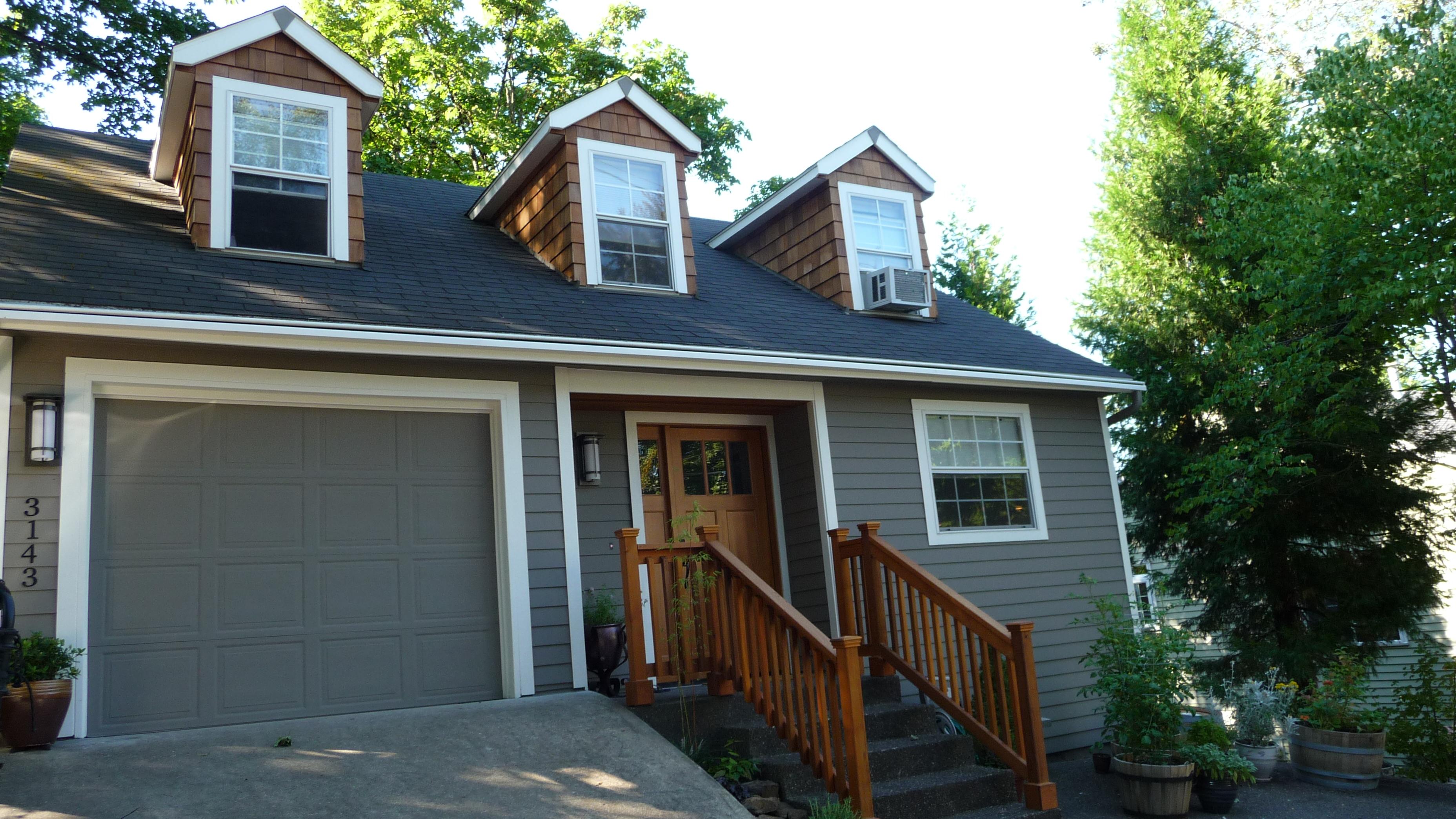 cedar shake dormers gray house