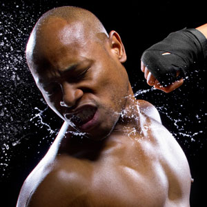 photo of boxer being punched wearing mouthguard