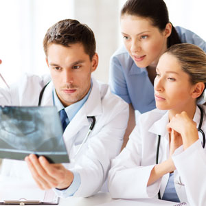 dentists observing teeth xray