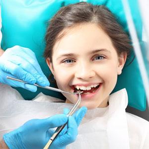girl getting fissure sealants in teeth