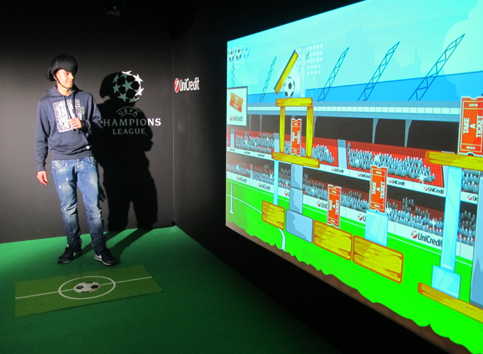 An interactive game inspired at Angry Birds could be played live during the Motorshow. Thanks to the interactive sensors the ball became virtual, the sensors read the strength and inclination of the ball that had to hit as many targets as possible, just like in the original game. Two cameras, led by an automized video switcher, recorded the player's reactions and his performance and each clip were automatically uploaded online on UniCredit's YouTube profile via youtube API www.youtube.com/unicreditchampions.