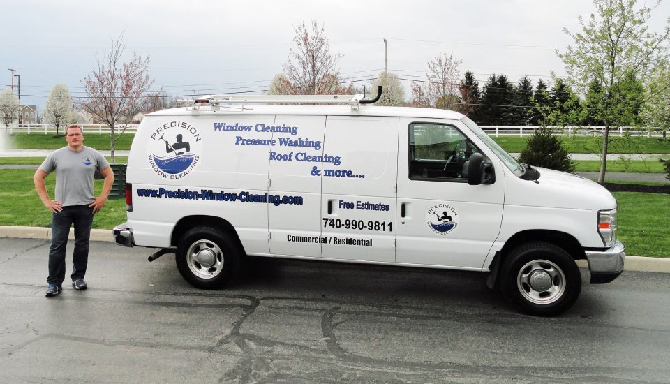 Precision Window Cleaning team member with van