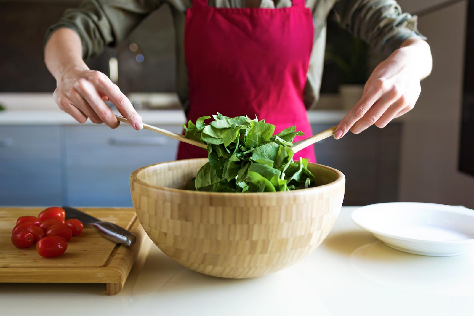 person preparing a salad