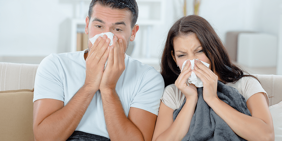 Couple Suffering With Chronic Sinusitis