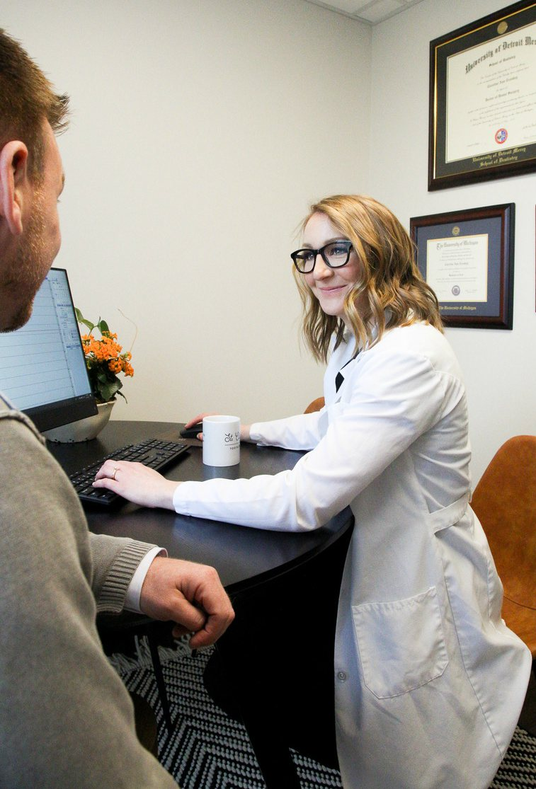 Dr. Cassleman consulting with a patient
