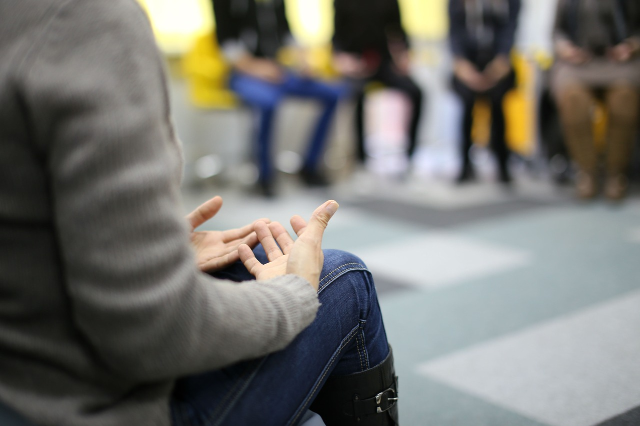 girl talking to therapy support group