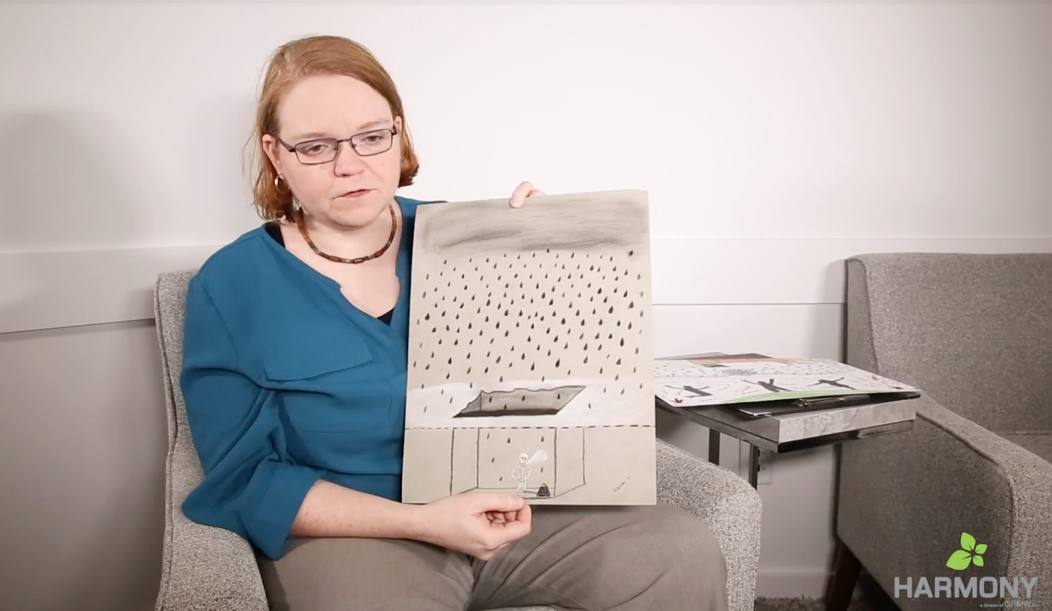 patient holds her art showing how depression feels