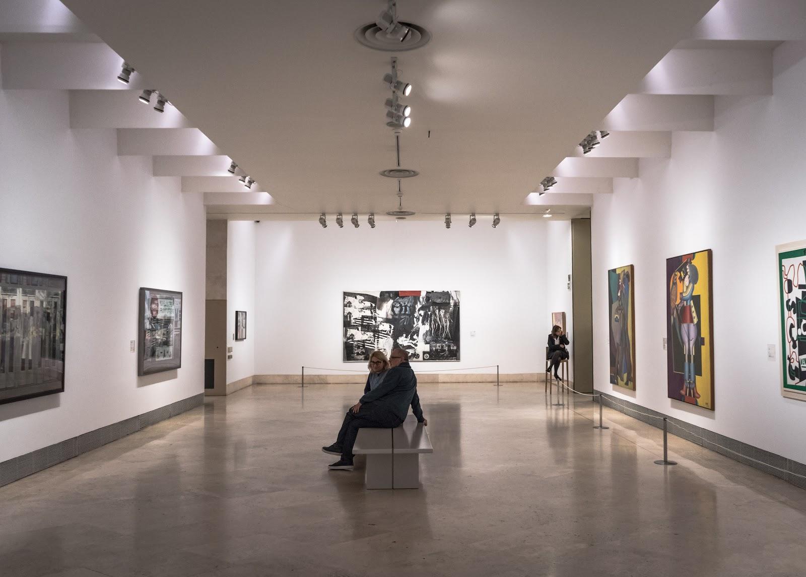 people sitting in art gallery