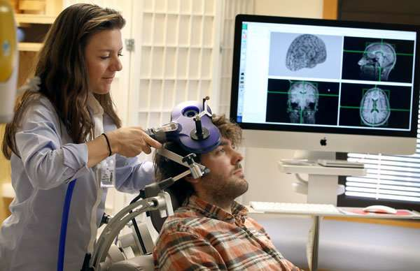 Doctor demonstrates TMS at Medical University of South Carolina (MUSC)