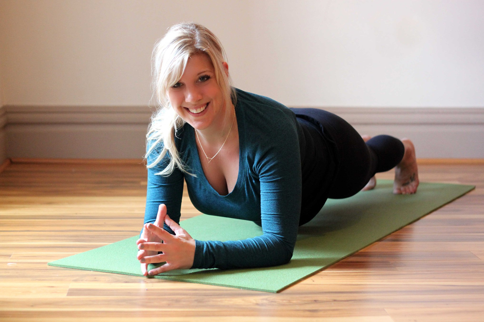 woman doing yoga as a part of a holistic mental health practice