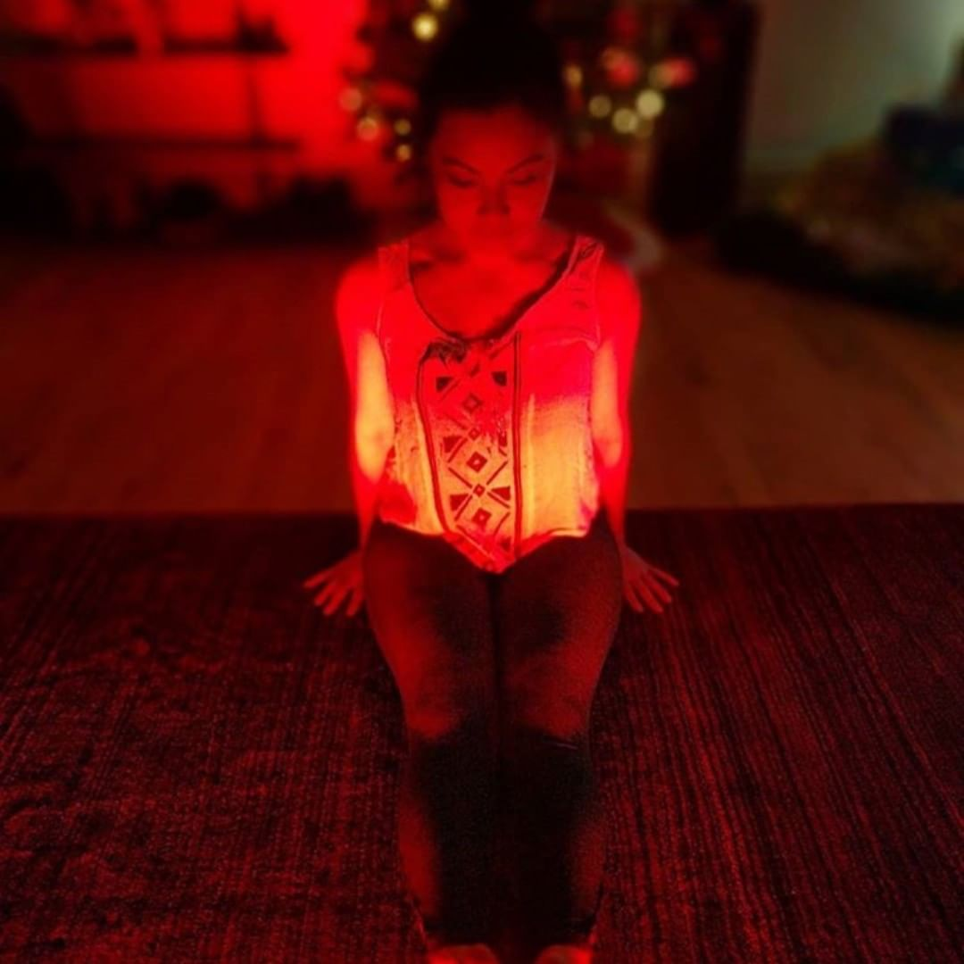 Woman meditating in red light