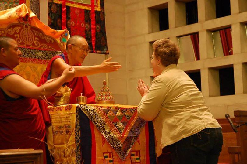 His Holiness 33rd Menri Trizin offering a blessing