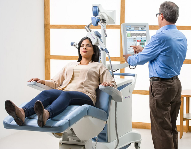 woman receiving TMS therapy