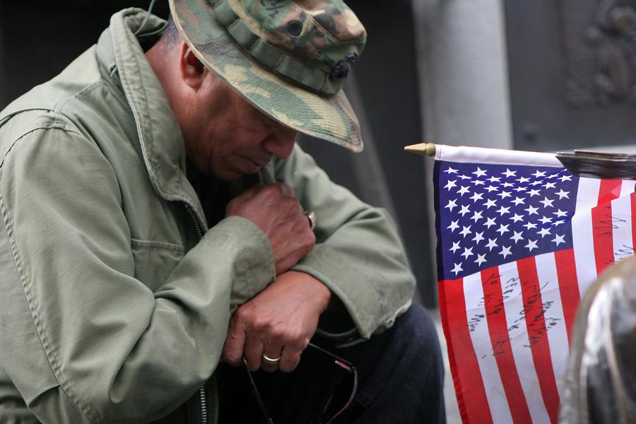 veteran near U.S. flag