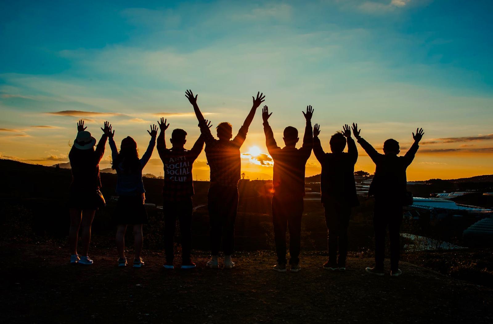 happy friends celebrating mental health, watching sunrise