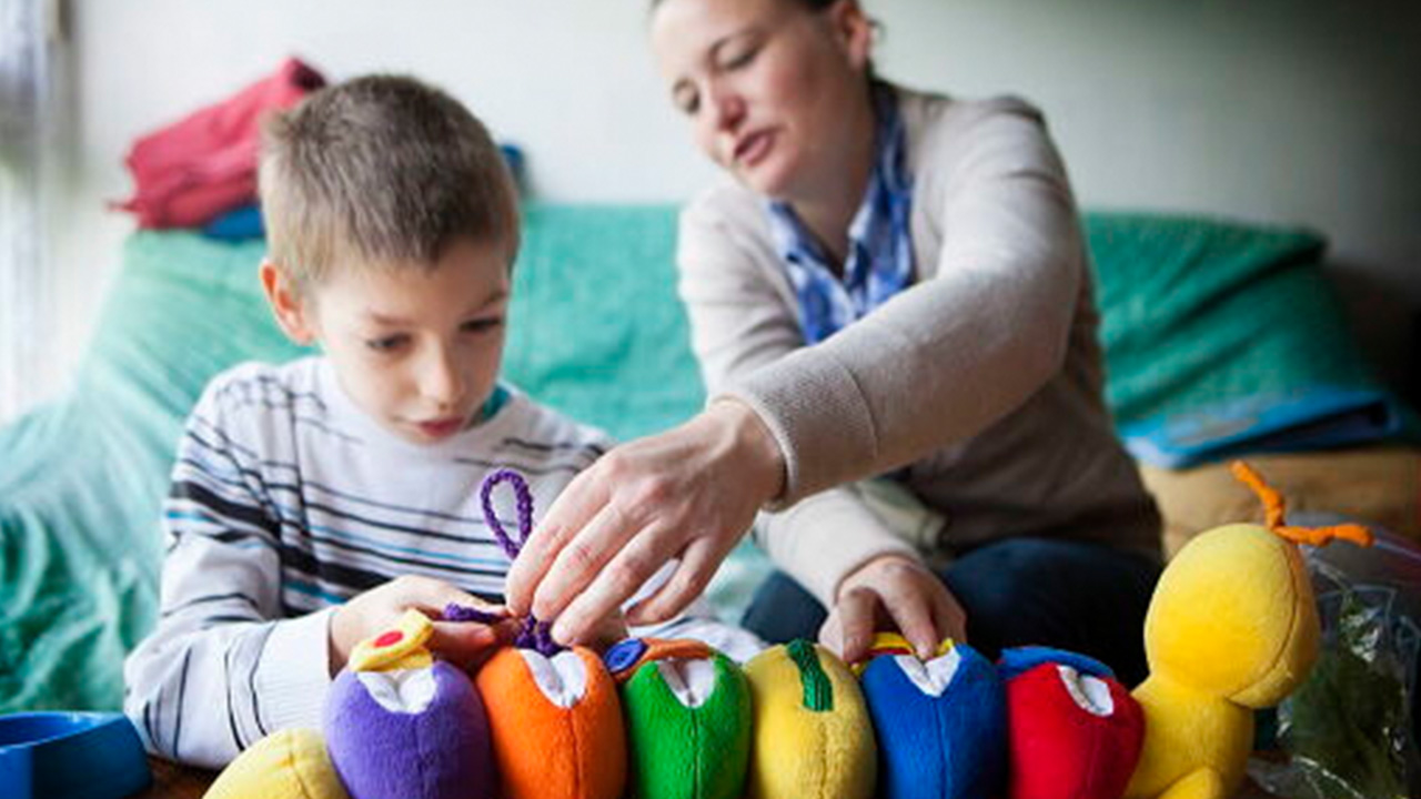 Child with Asperger's fascinated by colorful toys