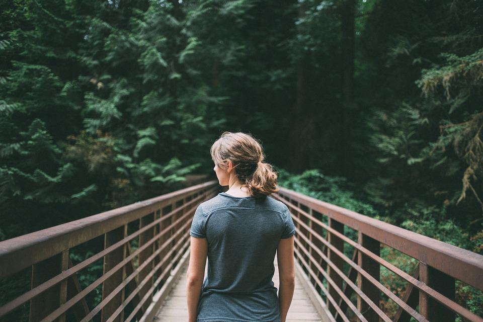 Woman crosses bridge