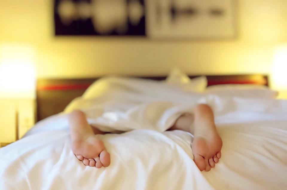 Woman sleeping in hotel bed