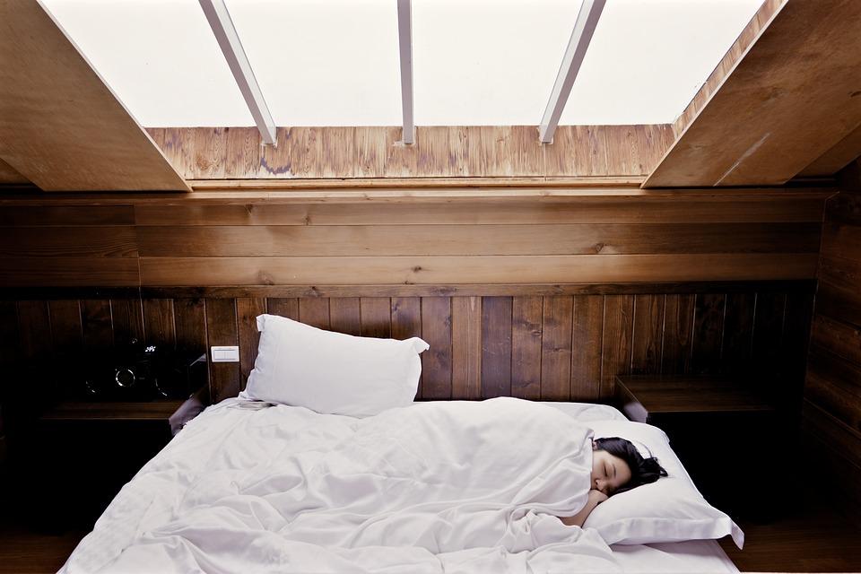 Woman sleeps in wooden cabin