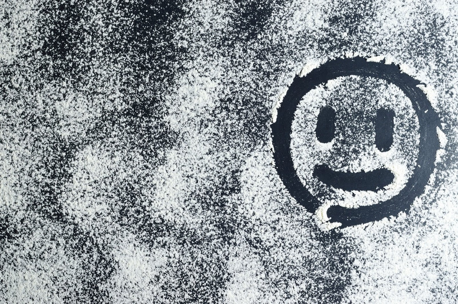 Smiley face on window drawn in the snow