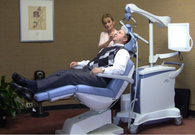 Patient receives TMS therapy from trained NeuroStar technician.