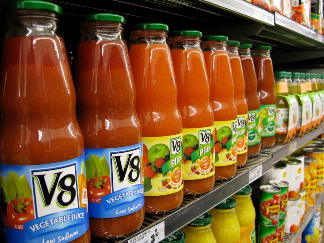 V8 bottles on display at grocery store.