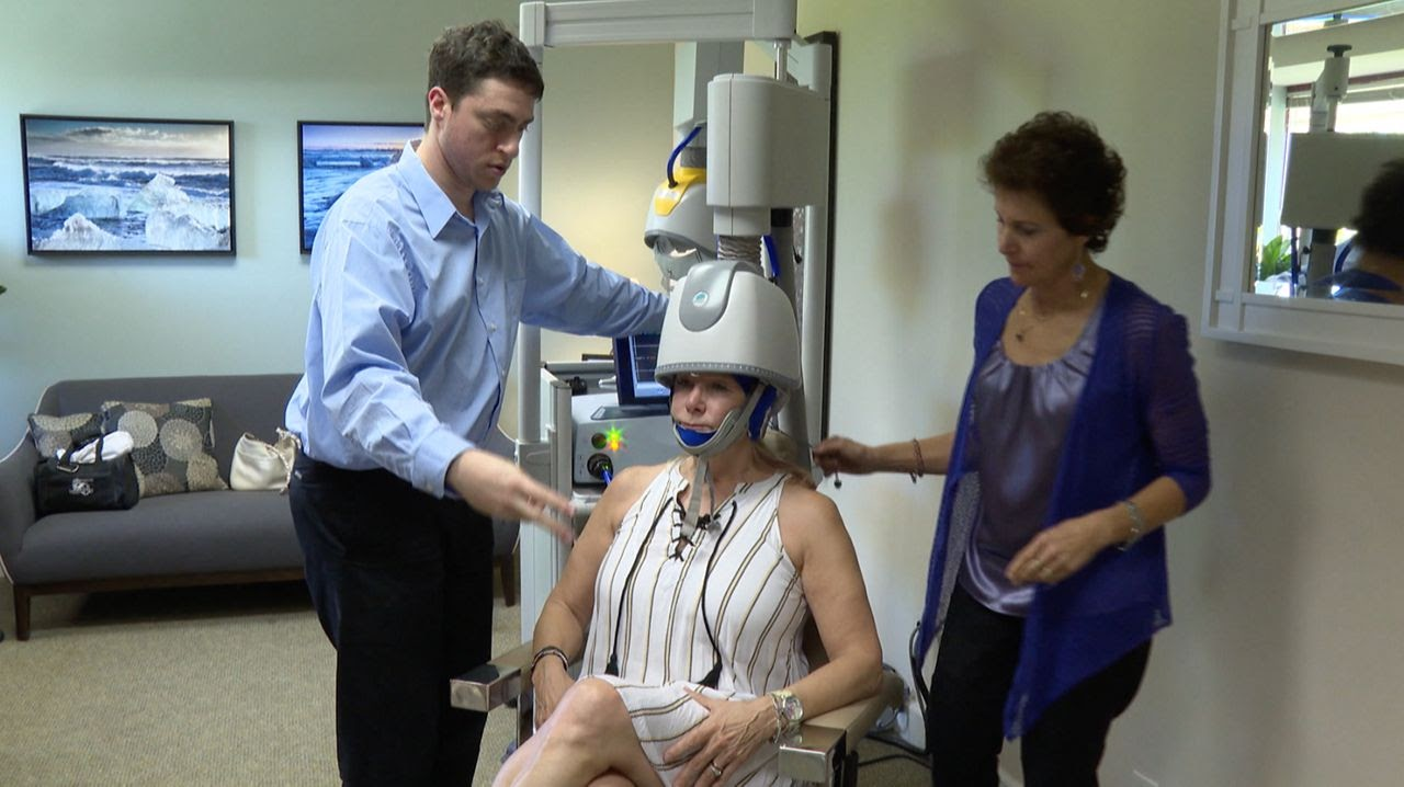 Woman getting TMS treatment