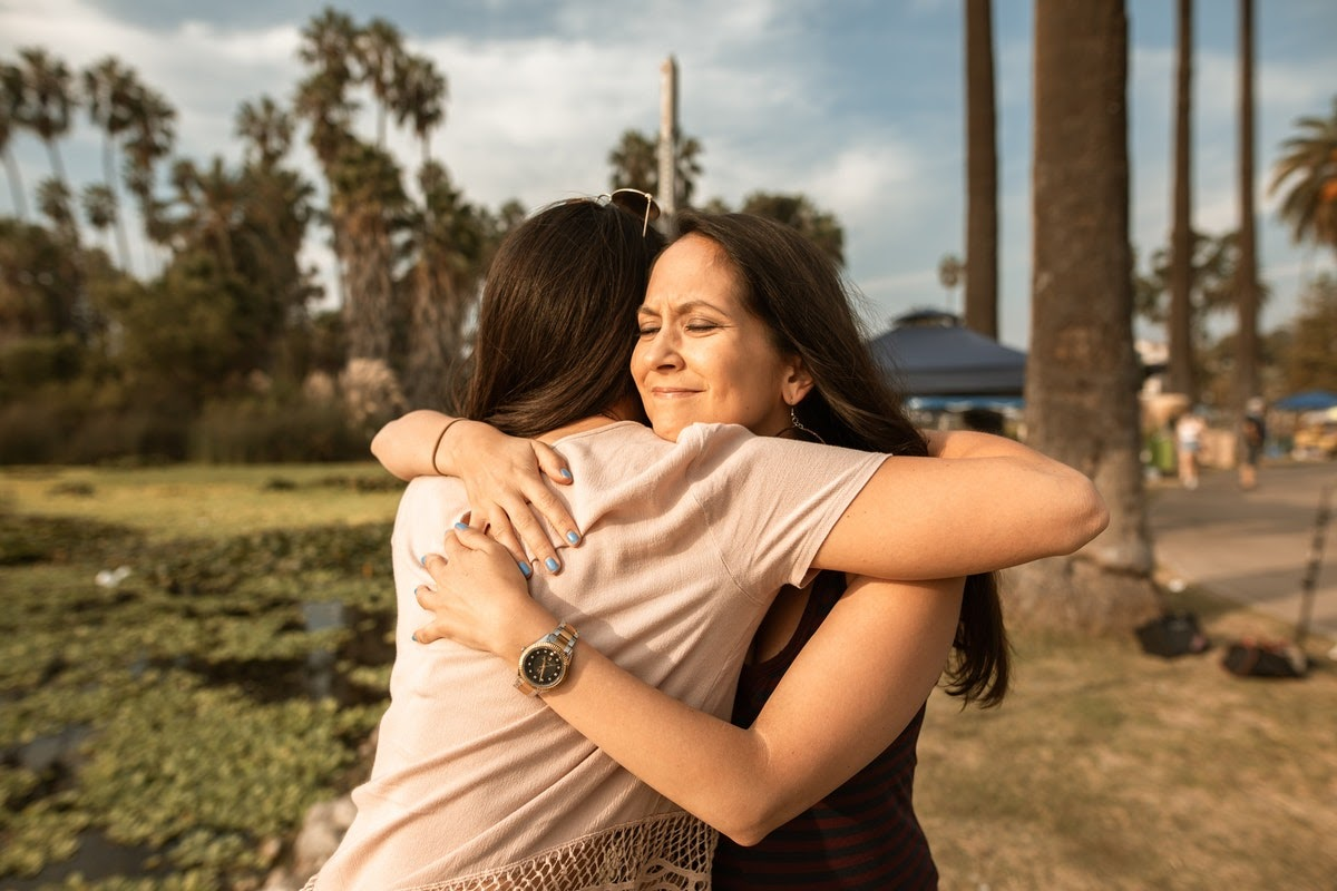 Woman hugging support system after TMS