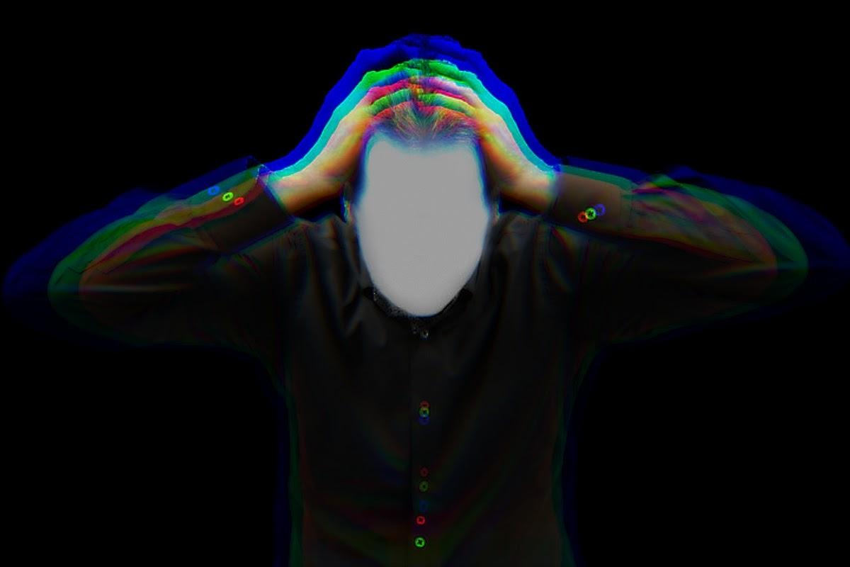 man grabbing head in frustration