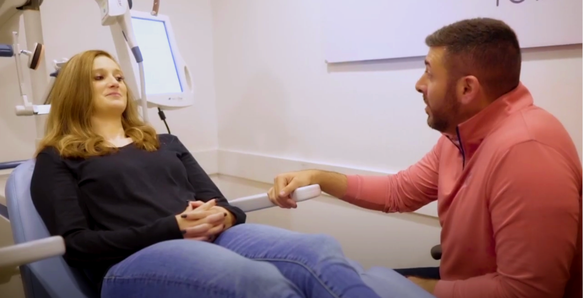 woman about to receive TMS treatment