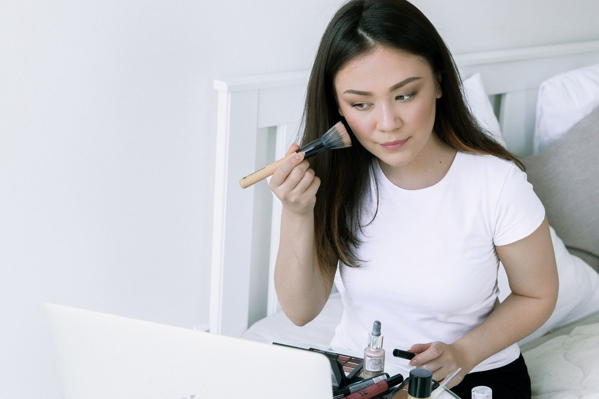 woman using technology while getting ready for the day