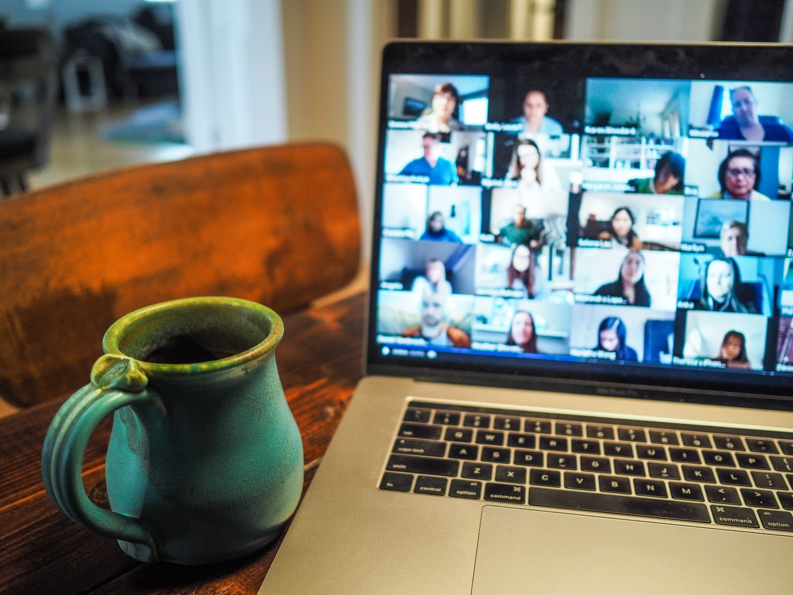 A virtual support group takes place on someone's laptop.