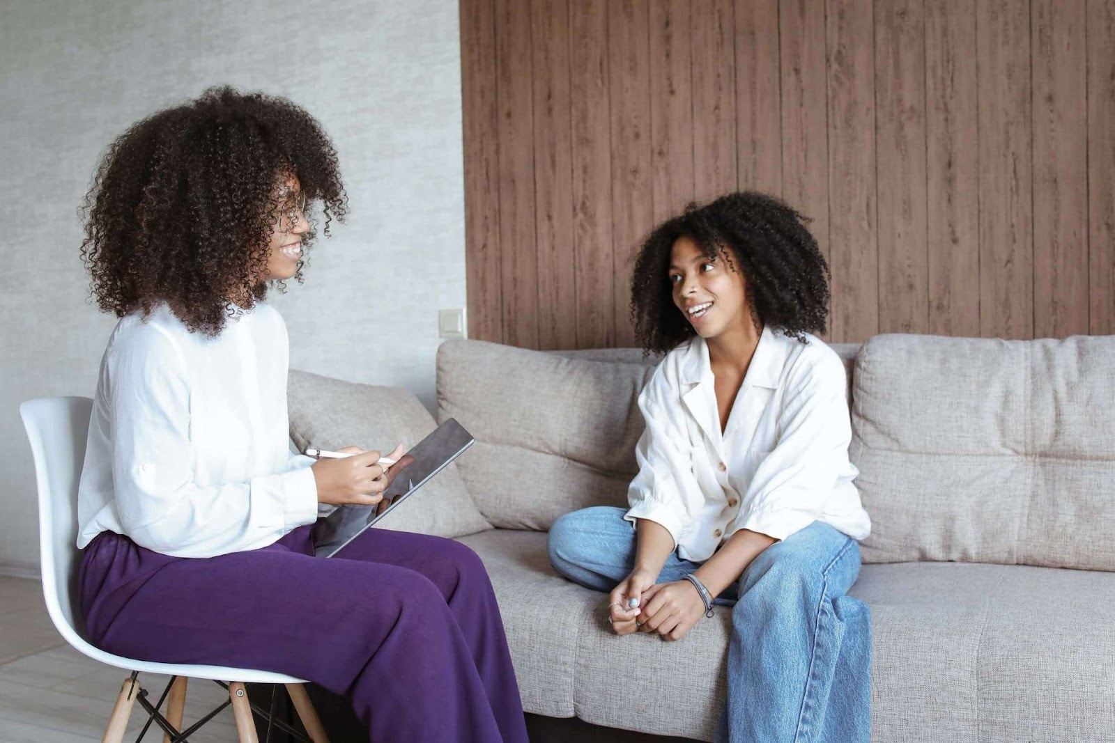A woman and her therapist, talking and smiling