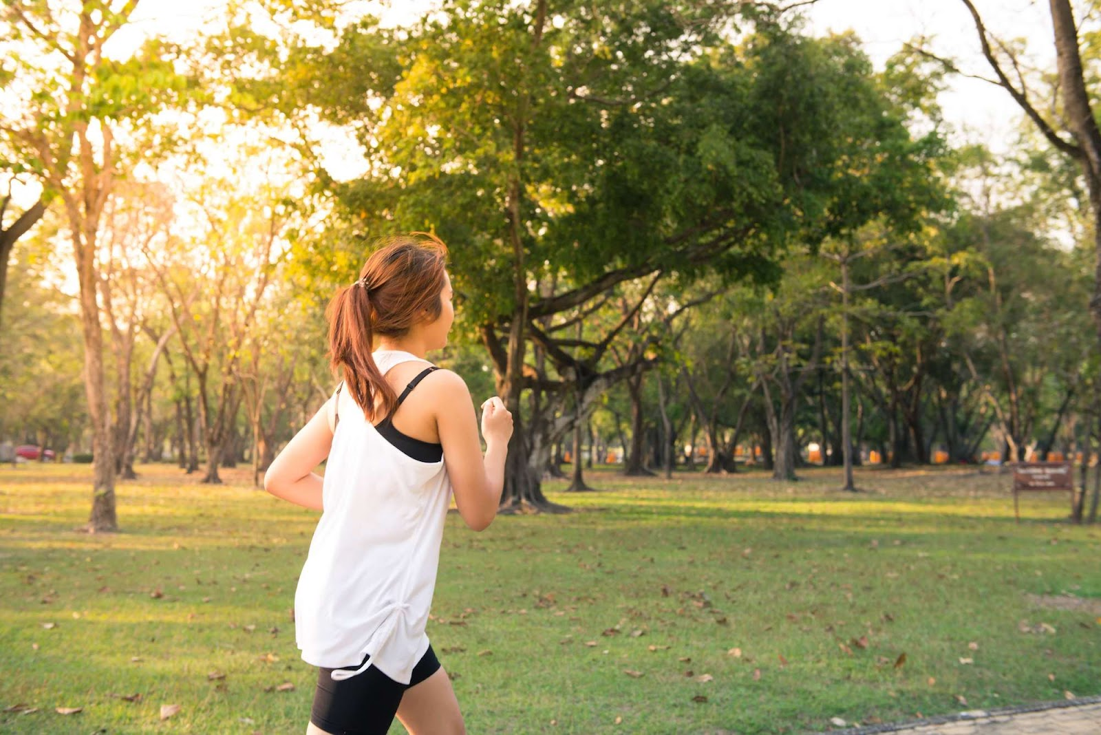 A woman running in a park