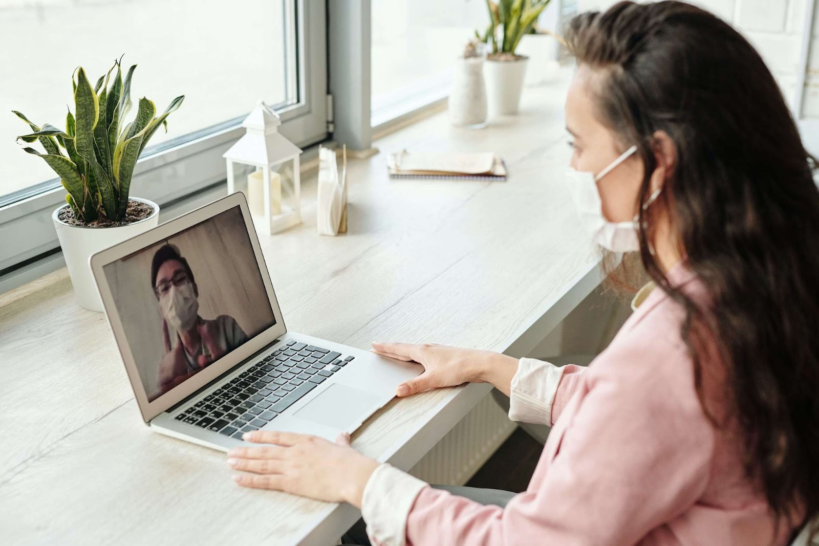 A woman speaking to her doctor through video chat