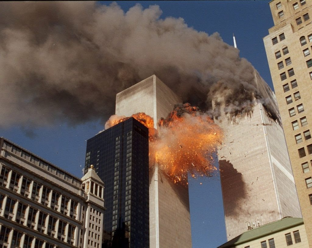 The World Trade Center goes up in flames as the second plane hits the tower. Chao Soi Cheong captured this photo of the North Tower of the World Trade Center. Image courtesy of breitbart.com.