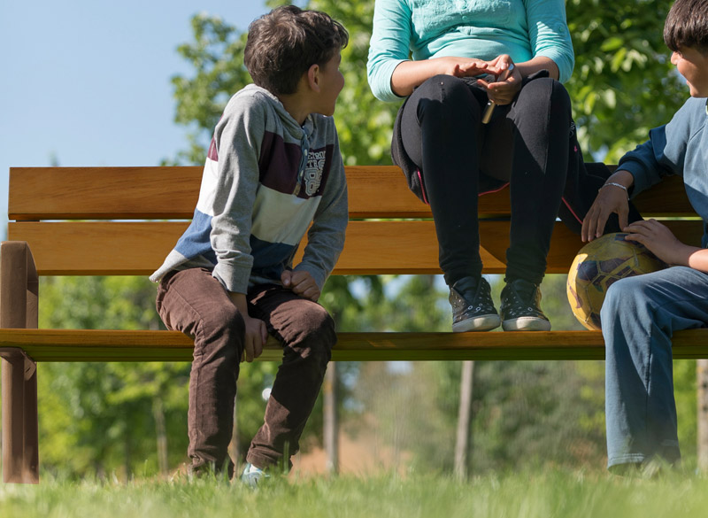 Children sitting on park bench